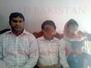 Sardar Mushtaq Gill (l) with Christian couple, Maria and Emmanuel Masih who face death threats. Their faces have been hidden due to security concerns.