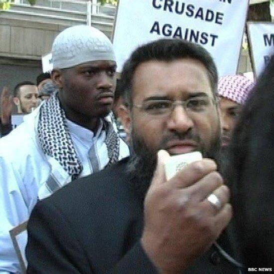 Rally: Anjem Choudary preaches with Woolwich suspect and Michael Adebolajo (circled) behind him at a demonstration in 2007. He called Adebolajo a 'nice man' in video rant released today