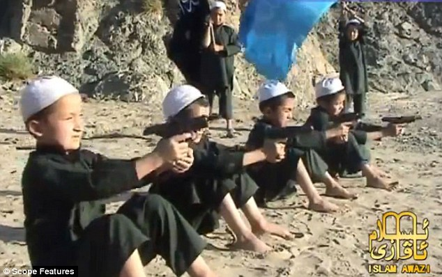 Future threat: Taliban children aged five are pictured being trained to fire guns by extremists in Afghanistan