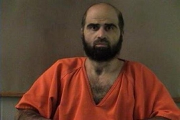 Nidal Hasan, charged with killing 13 people and wounding 31 in a November 2009 shooting spree at Fort Hood, is pictured in an undated handout photo .