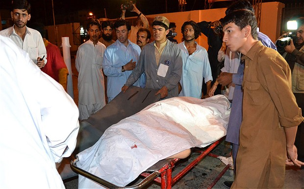People shift bodies of the victims of a suicide bomb attack targeting Shia Muslims in Quetta