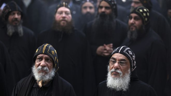 Clergymen gather to wait for the arrival of Egypt's Coptic Christian Pope Tawadros II, at the historic al-Muharraq Monastery, a centuries-old site some 180 miles (300 kilometers) south of Cairo in the province of Assiut, Egypt, Tuesday, Feb. 5, 2013. Egypt's Coptic Christian pope sharply criticized the country's Islamist leadership in an interview with The Associated Press on Tuesday, saying the new constitution is discriminatory and Christians should not be treated as a minority. (AP Photo/Khalil Hamra) (AP2013)