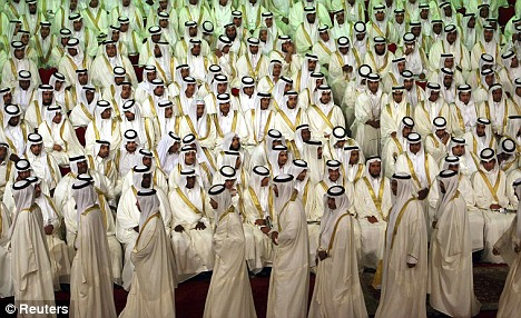 Grooms take part in a mass wedding ceremony in Riyadh in June. Governor of Riyadh Prince Salman and a local group organized a mass wedding for about 1600 couples to help people unable to afford expensive ceremonies.