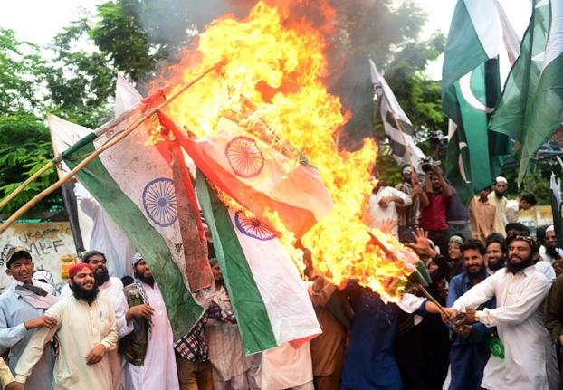 Supporters of Pakistan's outlawed Islamic hardline Jamaatud Dawa (JuD) torch Indian flags. PHOTO: AFP