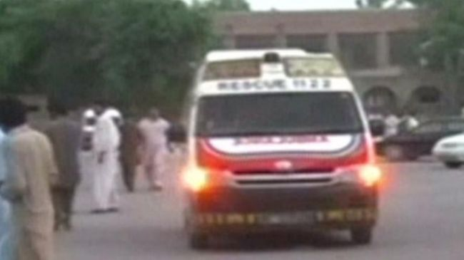 An ambulance carries away a person injured in Friday's clashes in central Pakistan.