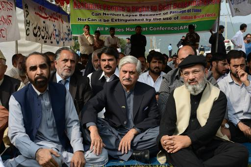 President of Pakistani-controlled Kashmir Sardar Muhammad Yaqoob Khan (C) sits in a protest along with other leaders outside the United Nation office in Islamabad on October 27, 2013