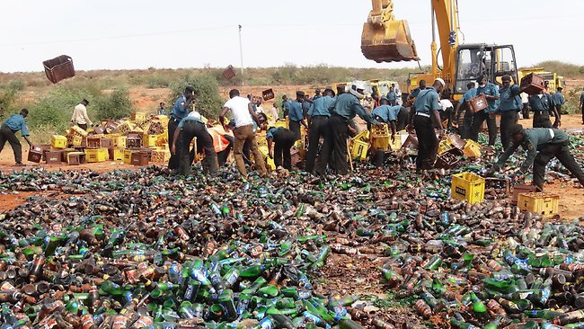 Sharia enforcers destroy thousands of bottles of beer outside northern Nigeria's largest city of Kano. Source: AFP