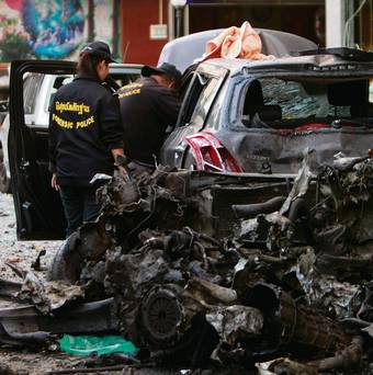 Thai security personnel inspect a vehicle at the site of a bomb attack in Songkhla province, south of Bangkok