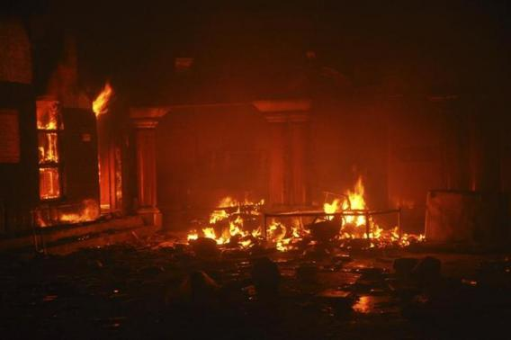 A Hindu temple burns after it was attacked in Larkana by Muslims, southern Pakistan's Sindh province, March 15, 2014.