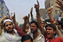 Protesters chant slogan as they react to a rumour that a member of the Hindu community had desecrated the Koran, in Larkana, southern Pakistan's Sindh province, March 16, 2014.