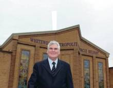 Pastor James McConnell outside his church, the Whitewell Metropolitan Tabernacle